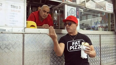 Sleek The Elite and Paul Fenech in 'Pat Pizza: Back In Business'. Image: Twitter